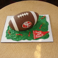 Football Birthday Cake this was a cake for a 60th B-day. He is a 49ers fan. It was a fun cake and my first carved cake.