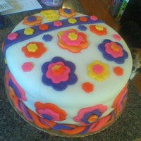 Groovy Flower Cake This was my first cake and my fondant didn't work out too well. But my daughter LOVED the tie dyed flowers.
