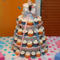 "Cupcake Tower My first cupcake tower :) 65 cupcakes with a 6"" cupcake topper.My first human figure. Thank goodness for youtube! The cupcake tower..."