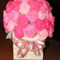 "Cupcake Bouquet - Large Large cupcake bouquet - made with a 6"" styrofoam ball.Held about 55 mini cupcakes. Rosettes made with buttercream."