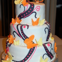 "Butterflies Butterflies made of gumpasteColor combination request of customer - came out better than I thought it would.Two tiers - 8"" and 10&quot..."