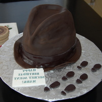 "Spy Cake Spy Cake - carved from 3 - 9"" cakes made of dark chocolate cake. Covered in fondantEdible image message printed backwardsFootprints..."