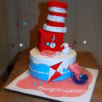 "Dr. Seuss Cat In The Hat 3 Tier - Hat sculpted completely out of Krispy Treats using 4"" inch pansBox is carrot cake with cream cheese icing - 6"" square -..."