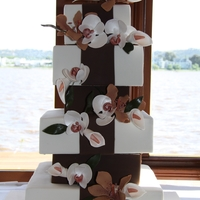 "6 Tier   Based on a Minette Rushing design. 12"", 8"", 10"", 6"", 8"" and 6""Lilies, moth orchids and callas all gumpaste"
