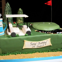Golf Themed Birthday Cake This was for a birthday/ retirement for a golf lover. Everything is fondant or gumpaste. Thanks for looking :)