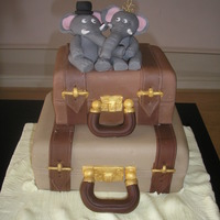 Suitcase Cake First attempt at a suitcase cake. For fun added a male and a female elephant. They could pass for a bride and groom.