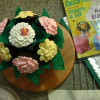 Cup Cake Bouquet Made my mom's friend a cupcake bouquet, she is right now fighting breast cancer and i just wanted to brighten up her day. :) The...