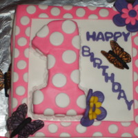 Addison's 1St Birthday!   Grandkids keep my hobby of cake creating busy! :)Butterflies are made out of rice paper......they were fun to make!