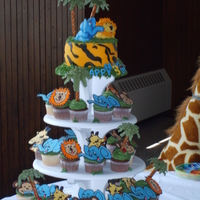 "Jungle Cake And Cupcake Tower Seamus' 3rd Birthday......Jungle Theme cake and cupcakes. He wanted ""blue"" elephants.....I am having a lot of fun with color..."