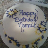 Purple And Yellow Birthday Cake This is our 2nd fondant cake. This one went SO much better than the 1st one. This is a simple cake but it turned out really nice. (yellow...