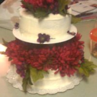 Buttercream With Silk Flowers A friend of mine requested this cake... keep in mind that I am a novice, this was my first tiered cake!! Buttercream with silk flowers. TFL...