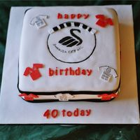 Football Cake   I made this for a football fanatic,it's his favourite team,the logo was hand painted on the cake.