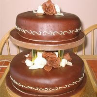 Rose Chocolate Wedding Cake I made this for a friend,who loves chocolate,It was the first time I used pillars,I was a bit nervous in case they were not central but it...