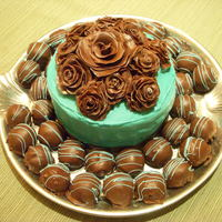 "Chocolate Roses This is a small cake (3 layer-6"") it is coconut cake with coconut buttercream icing. The roses are chocolate modeling clay-it was my..."