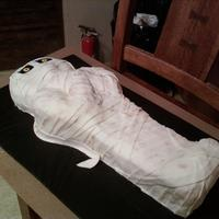 "Mummy  23"" mummy made with vanilla cake and wrapped in MM fondant. This was made for a silent auction the day before halloween and sold for..."