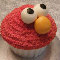 Cupcake Elmo   This is a giant cupcake decorated in fondant and buttercream icing. Thanks for looking!