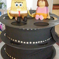 Spongebob And Dora Go To The Movies! fondant covered cake with fondant details. Thanks for looking!