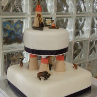 Native Themed Cake Native themed cake. Fondant covered cake with fondant and gumpaste details and native figurines. TFL