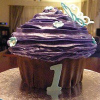Giant Cupcake   Chocolate cupcake covered with buttercream icing and fondant. TFL