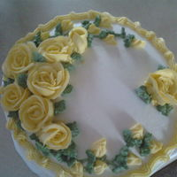 Yellow Roses Friend requsted a cake for a bereavement dinner. Was the deceased favorite cake. White cake with Lemon curd filling. Her favorite flowers...