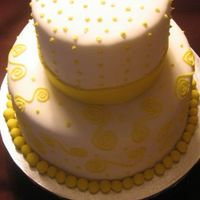 Yellow And White Yellow and white cake covered in fondant with bc accents.