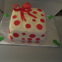 Christmas Gift Square Christmas box, cream cheese/buttercream icing, red fondant bow and circles.
