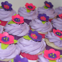 Bright Purple WASC cupcakes filled with vanilla; fondant cutouts. cream cheese frosting