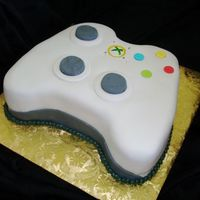 X-Box Controller Coworker's husband is a video game fan. This was for his birthday. Lemon cake with fondant.