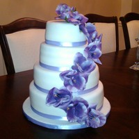 Birthday Cake 6,8,10,12 inch covered in Fondant. Silk flowers and ribbon