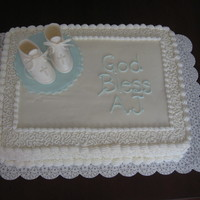 Boy, Baptism And Booties Gumpaste booties and BC decorated cake.