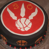 Let's Go Raptors! fondant covered cake with fondant accents for my DH.