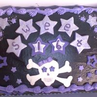 Untitled.jpg first cake... stars and skull and crossbones are fondant