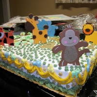 Zoo Animals zoo animals for a baby shower. 1/2 sheet cake baby blue van cake with rum. that's what the customer asked for. plus A..B..C blocks