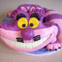 Cheshire Cat - From Alice In Wonderland This was my first sculpted cake, the cake was red velvet.