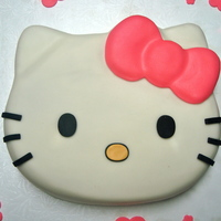 Hello Kitty Vanilla cake, vanilla buttercream, covered in MMF. Used Hello Kitty cake pan...