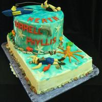 Water Skiing Scuba Gumpaste, fondant, rice crispy boat, chocolate rocks, piping gel