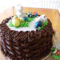 Easter Bunnies And Chick The basket weave is chocolate buttercream. The bunnies and chick are fondant.