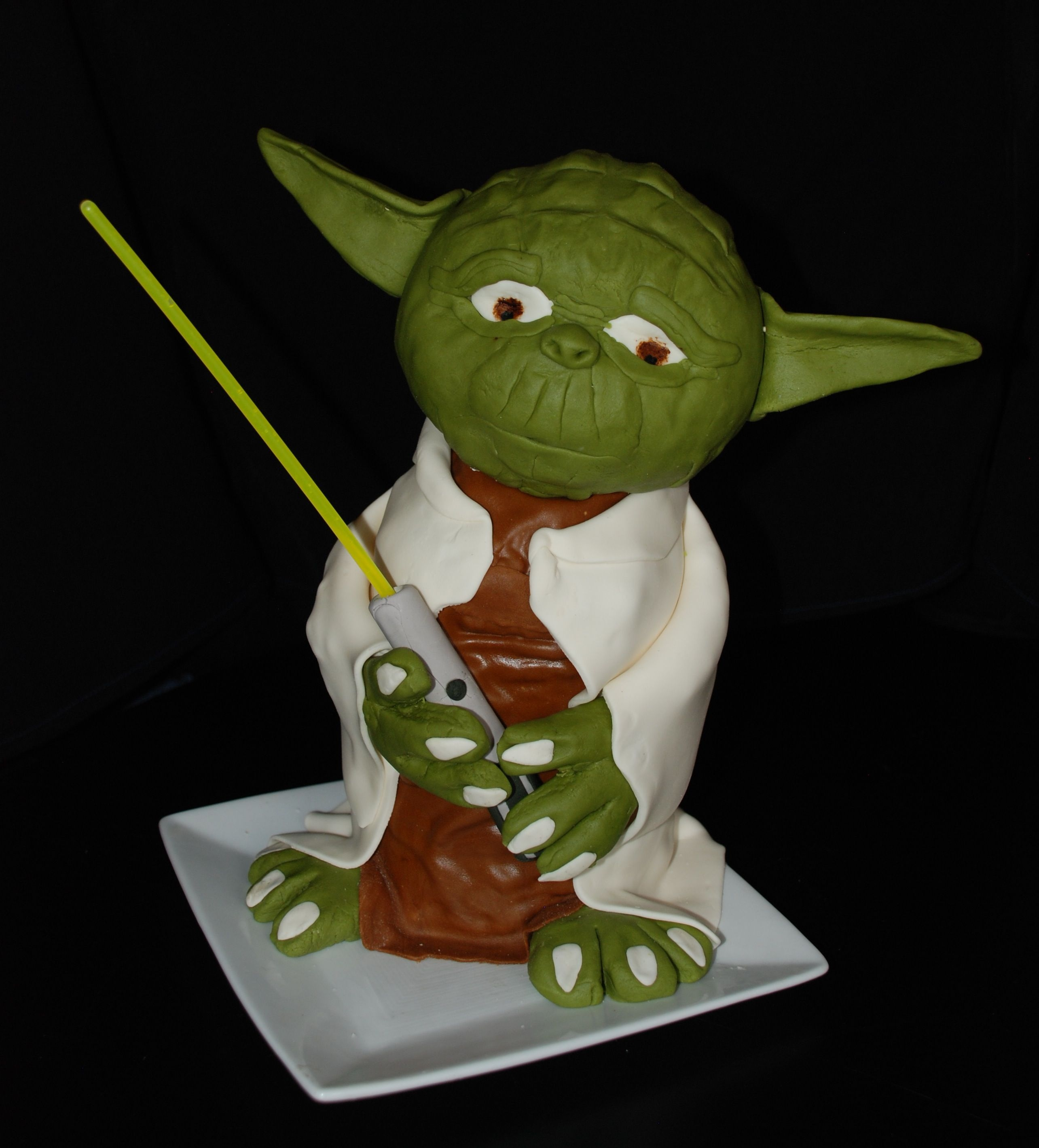 "Eat Me, You Shall. This is a Yoda cake I made for my neighbor boy's 7th birthday. It's a ""Wildberry"" cake with buttercream frosting and..."
