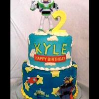 Toy Story Kinda getting tired of this cake this is the 3rd one i've made exactly the same!!!! Topper is inedible. TYFL Mark - Mexicano