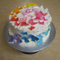 Butterflies  This cake was designed by a sweet 4 year old girl for her grandmother's birthday. Her request included marble cake, white icing,...
