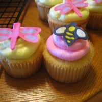 Mini Garden-Themed Cupcakes The dragonflies and bees were made of royal icing.