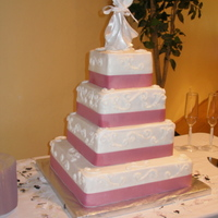 4 Tier Square Wedding Cake This is my 1st official wedding cake!!( I was very pleased with it)layers are a basic white cake recipe with all buttercream icing