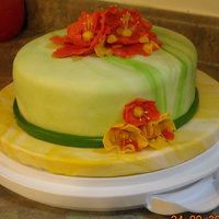 Wilton Course 4 Fondant My Wilton Course 4 cake. Marbleized MMF in greens for the cake and marbleized yellows for the cake board. I first made the bright orange...