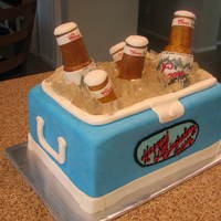 Coors Light Ice Chest Cake  My daughter made the rice krispy beer bottles...I hand painted the labels. Thank you to mommyle for the help with answering my question...