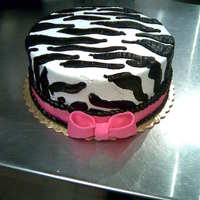 "Zebra Striped Cake   8"" round iced in whipcream with buttercream stripes. Fondant Bow"