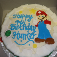 Super Mario Mario was royal icing which dried over the course of a week. The accents are fondant.