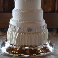 Ruffles And Ribbon Wedding Cake The bride provided a picture of the cake she wanted, but with a few tweaks. She wanted silver and slate blue incorporated in the cake. The...