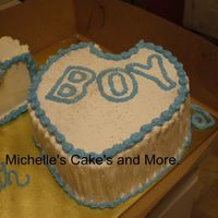 Baby Bib This was with the Baby blocks No filling just yellow cake and alot of vanilla and milk used went I did the frosting. Thank you for looking...