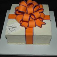 Orange & Purple Present Birthday present cake with Orange and Purple bow by request.