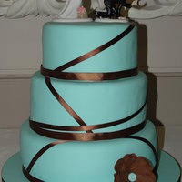 "Teal And Brown Round Ribbon 12"",10"", 8"" rounds covered in fondant with gumpaste anemone. My very first wedding cake. There are some flaws and things I..."